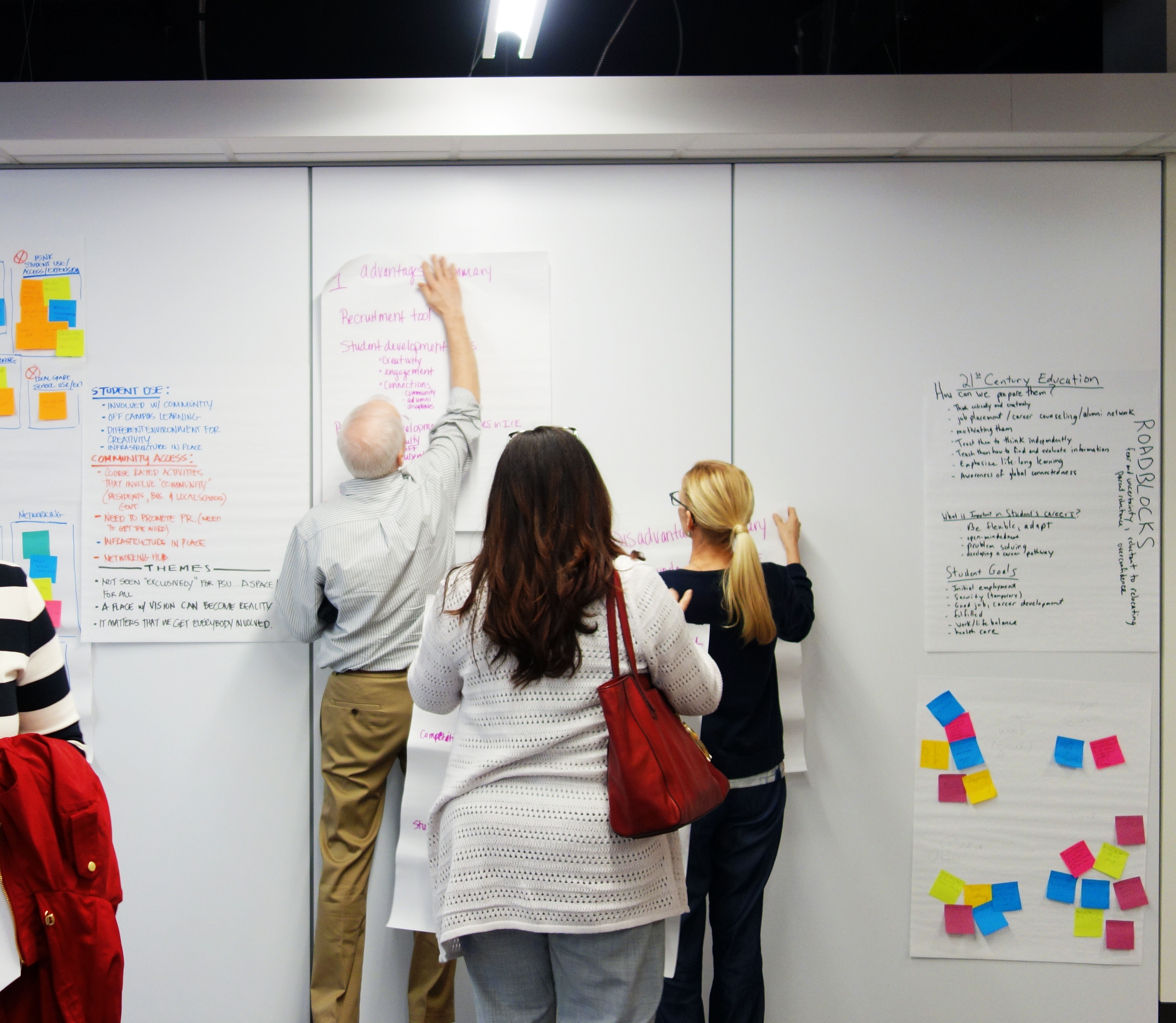 Faculty and staff post their brainstorming ideas on a wall during Corner CON 2018