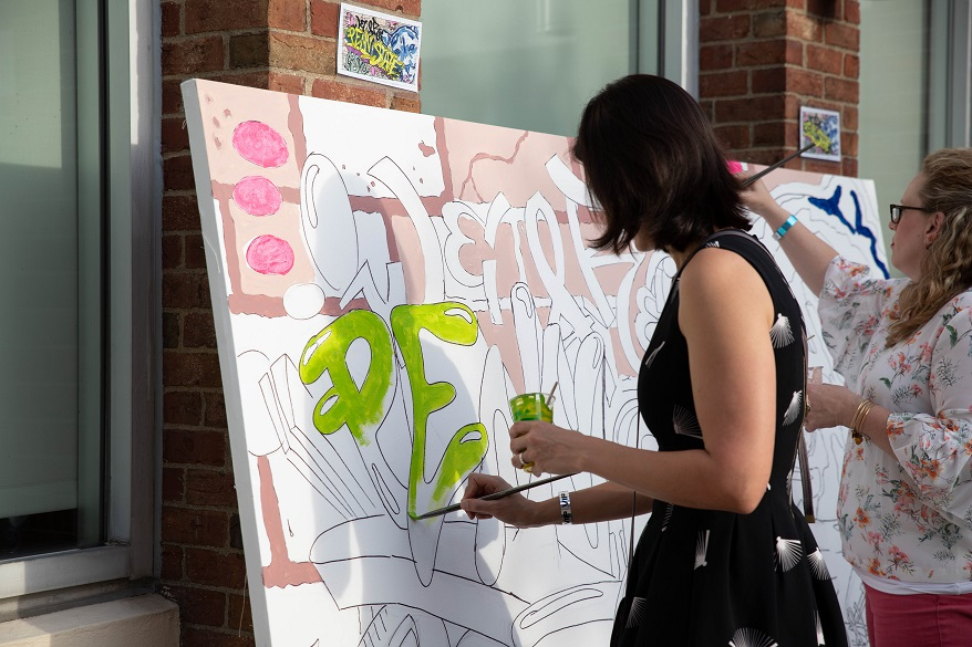 Guests paint mural at the 2018 Off the Wall pARTy
