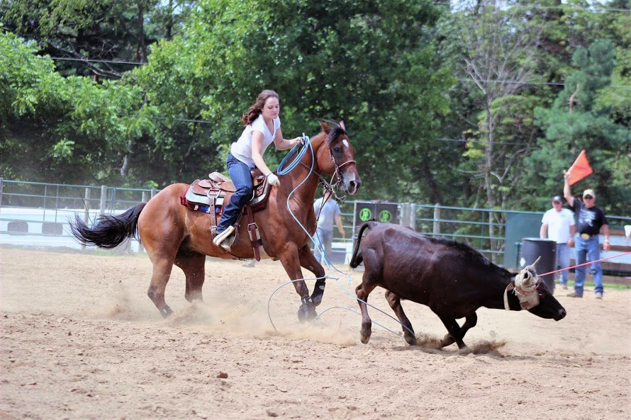 Olivia Sribniak on horseback during a roping competition