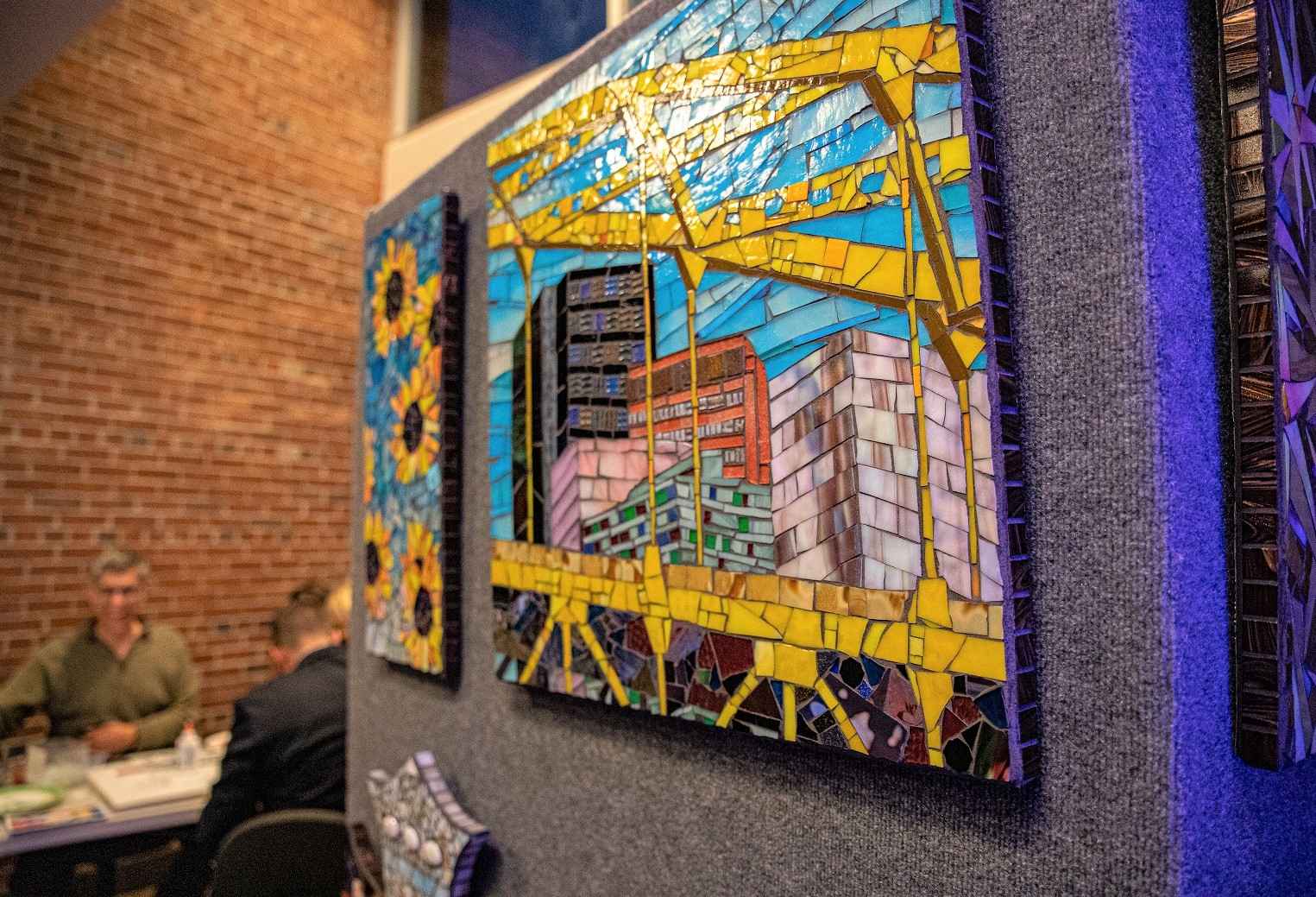 Glass mosaic art hanging on wall