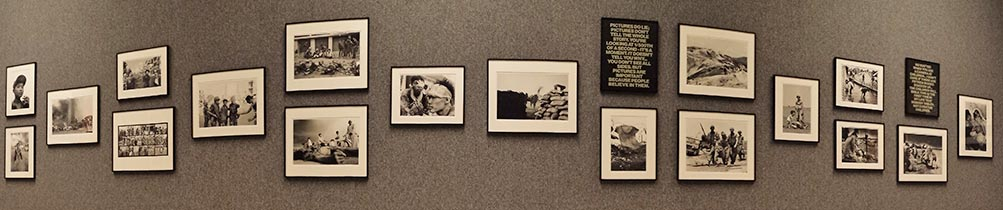 grey art gallery wall full of black and white photos