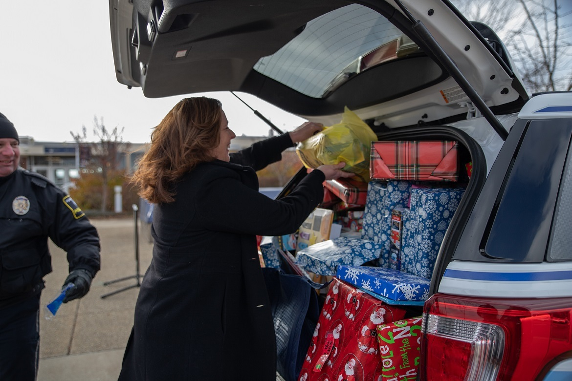 Woman places gifts in car