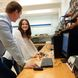 Olivia Sribniak smiles at project partner Anthony Gyke in engineering lab