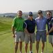 Golfers pose for photo at golf outing