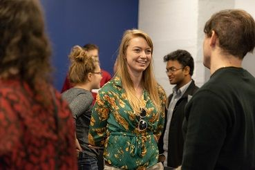 Female student smiling at event