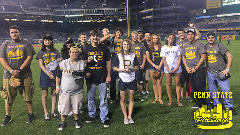 Students play catch on the field at PNC Park