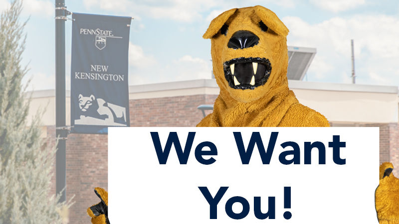"""Nittany Lion mascot holds sign reading, """"We Want You!"""""""