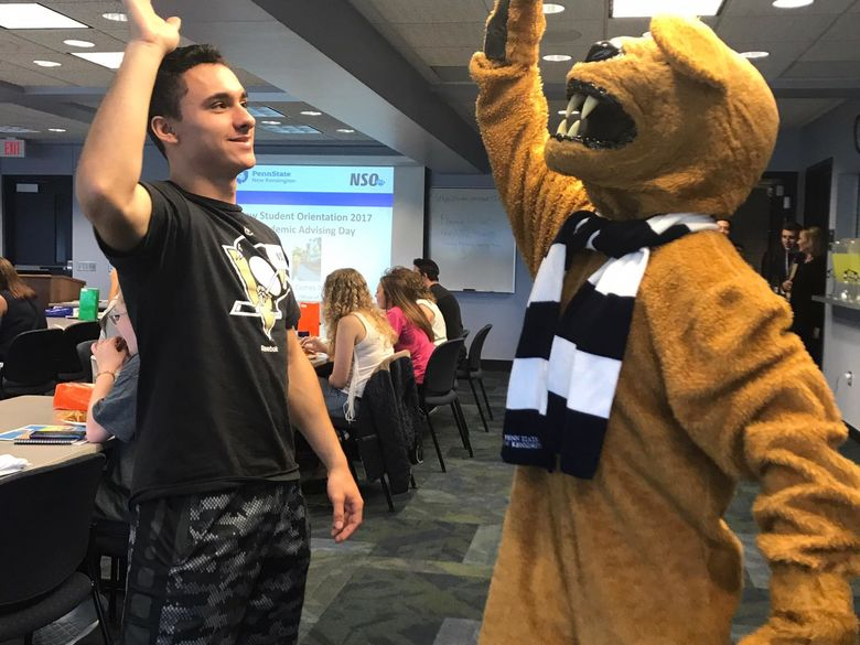 Student with Nittany Lion mascot at Orientation