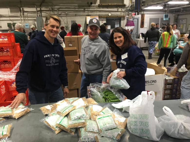 Alumni Working at Food Pantry