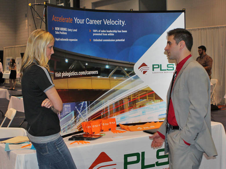 Male student talks to an employer at the Career Fair