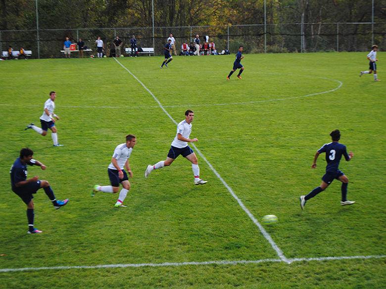 Soccer players on a break away