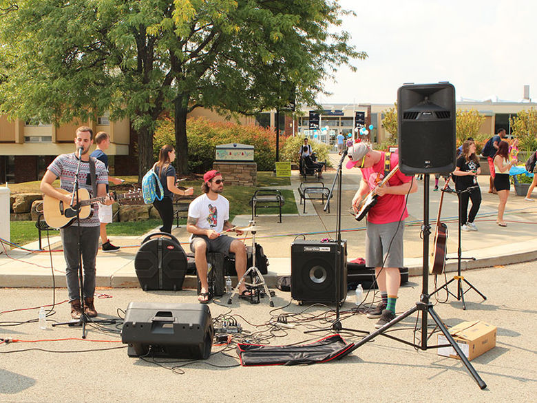 A band performs at the entrance to the campus during the Back to School Bash