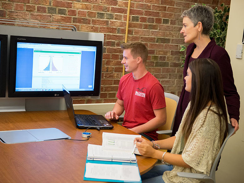 Communications students share their work with their professor via a laptop that is connected to a MediaScape system