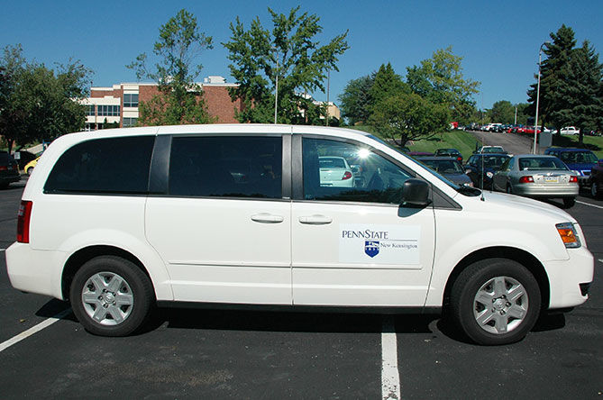 Campus shuttle in a parking lot