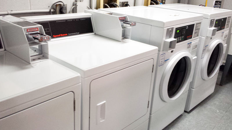 Coin-operated washers and dryers in the laundry room.