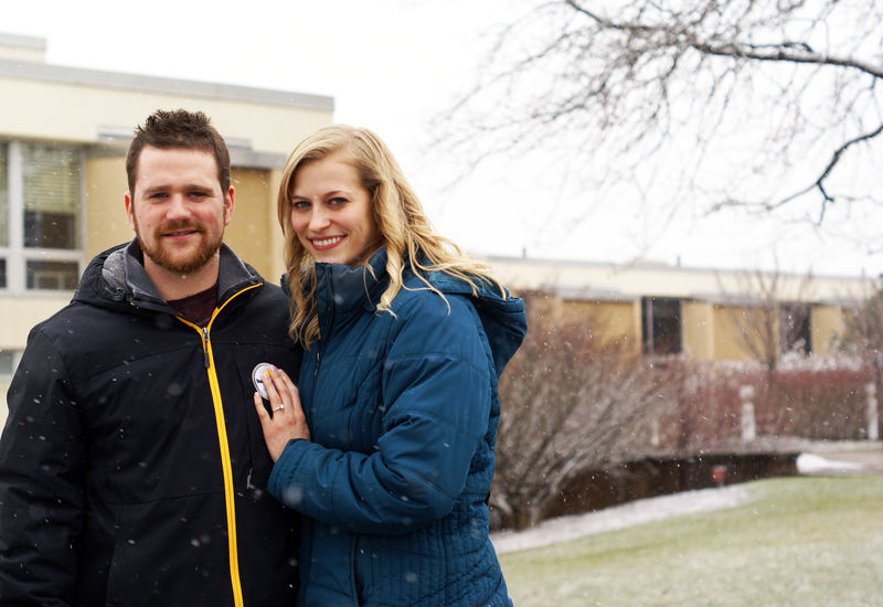 Greg Zyhowski and Ashley Myerski stand in front of New Kensington campus