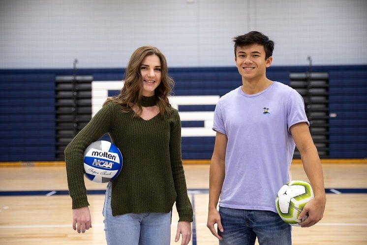 Woman and man stand in gymnasium
