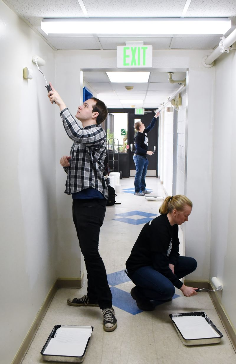 Two Penn State Behrend students paint a hallway during a MLK Day service project.