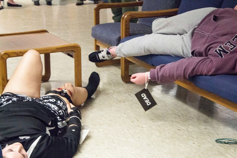Students play dead during an active shooter training at Penn State Beaver.