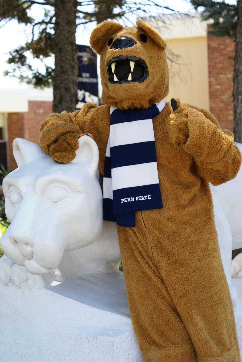 The Nittany Lion mascot poses for a photo at the Campus Lion Shrine