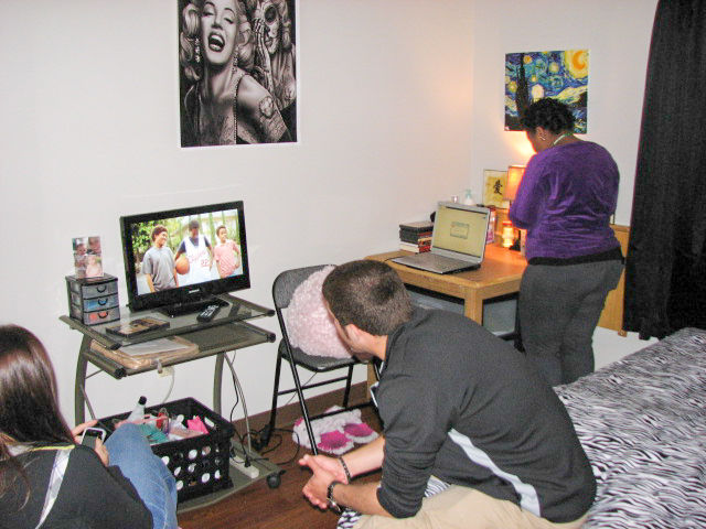 Students watching TV in a bedroom