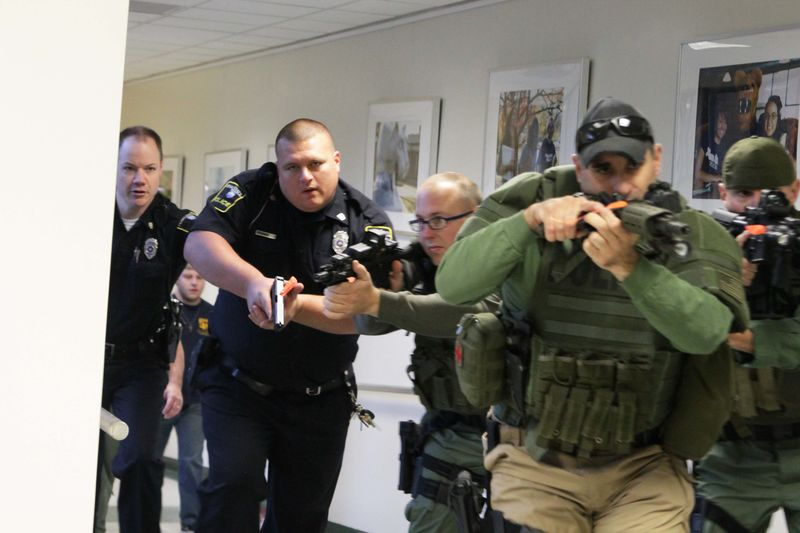 University police enter the Student Union Building during a training drill
