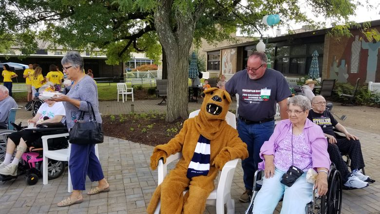 Penn State mascot sits with residents at Vincentian Senior Citizens Home