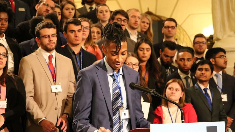 Student speaks at podium