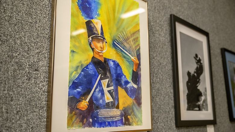 Watercolor painting of marching band drummer