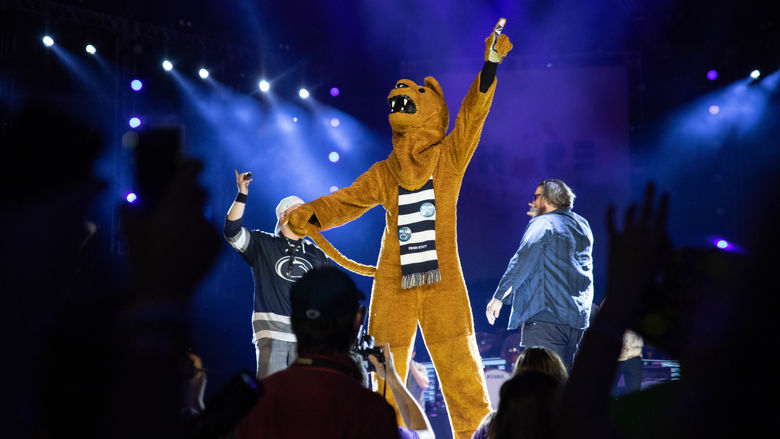 Nittany Lion mascot stands on stage
