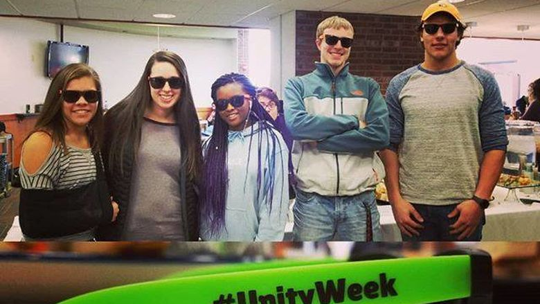 New Kensington students show off their new Unity Week sunglasses