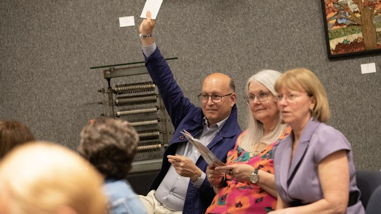 Man holds up number during art auction