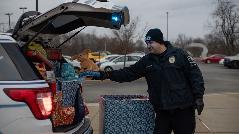 Police officer places gift in car