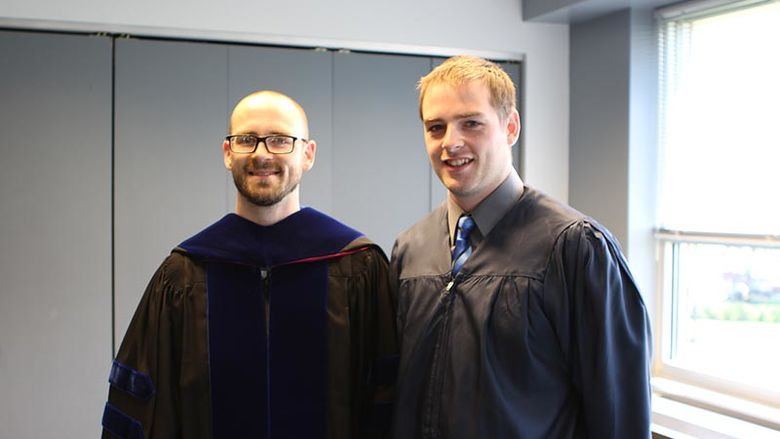 Dr. Roth and AOJ student before commencement