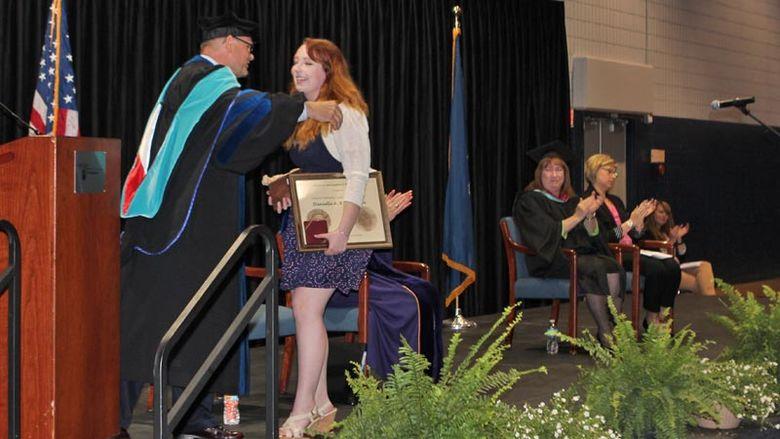 Chancellor hugs Richardson after she wins Walker Award