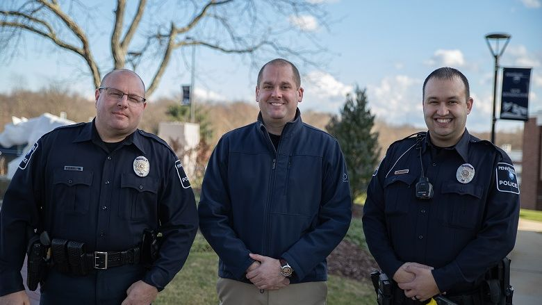 Three police officers standing