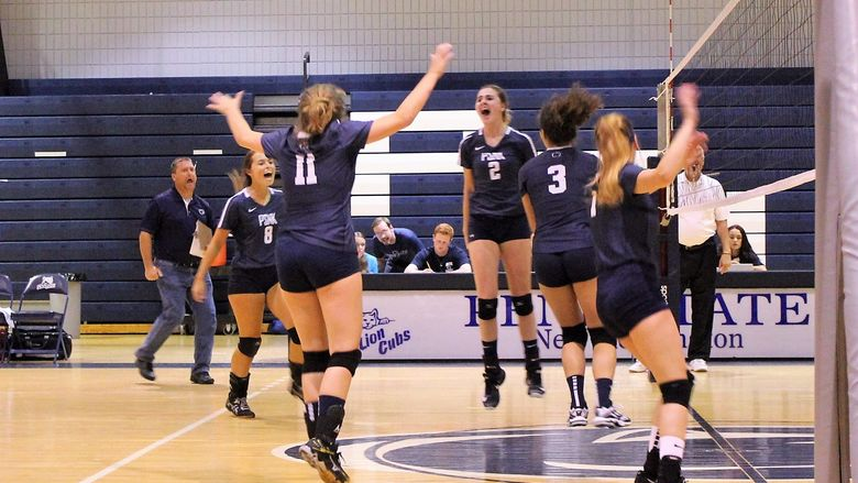 New Kensington volleyball team members jump in celebration