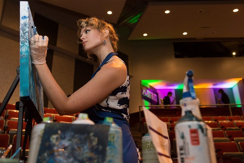 Sarah Hunter paints at the 2018 Off the Wall pARTy at Penn State New Kensington