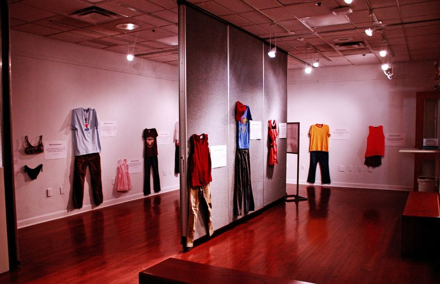 "Clothing from ""What Were You Wearing?"" exhibit hangs on walls of gallery"