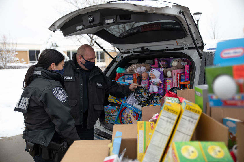 Police officers load cruiser with donated items